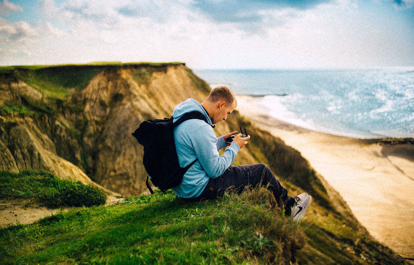 Denmark VSCO Beauty In Nature Casual Clothing Cloud - Sky Coast Cold Temperature Day Grass Horizon Over Water Land Leica Leisure Activity Lifestyles Nature Outdoors People Photography Themes Real People Scenics - Nature Sea Sitting Sky Technology Water