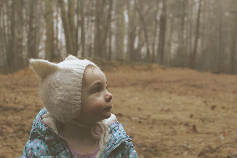 Cute baby girl at forest