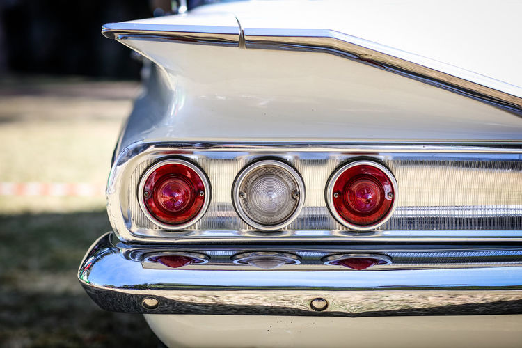 Close-Up Of Taillight Of Vintage Car During Sunny Day