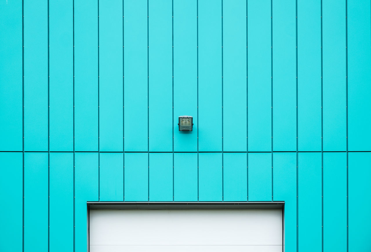 Electric Light Mounted On Turquoise Wall