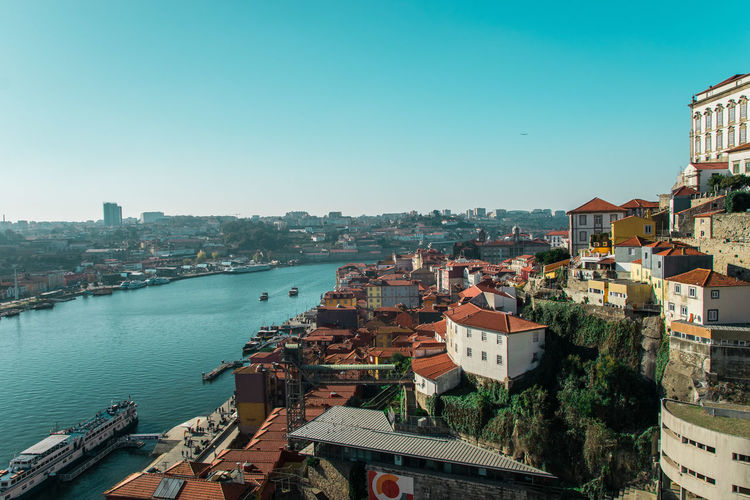 High Angle View Of Boats Moored On Douro River By Buildings Against Sky