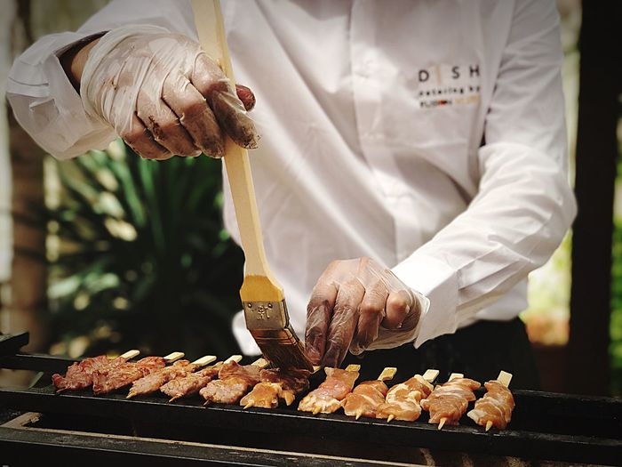 Grilling yakitori on Robatayaki. Preparation  Food And Drink Food Preparing Food Chef Men Real People One Person Close-up Showcooking Salento Italy Leuca Meat! Meat! Meat! Rethink Things Postcode Postcards