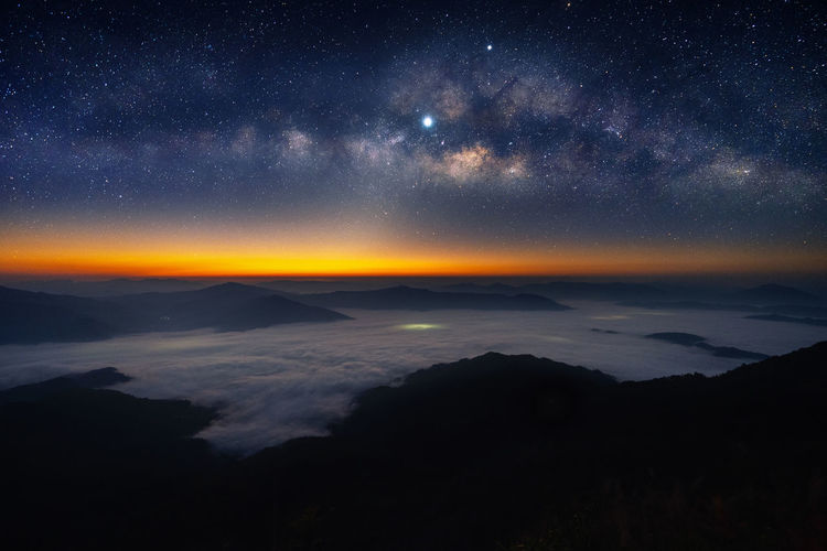 Milky way galaxy and star over mountains. Star - Space Sky Beauty In Nature Night Astronomy Scenics - Nature Space Tranquil Scene Tranquility Galaxy Nature No People Idyllic Mountain Star Star Field Cloud - Sky Milky Way Environment Non-urban Scene Outdoors Space And Astronomy
