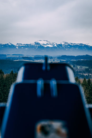 Binoculars Against Snowcapped Mountain