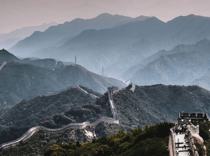 Aerial view of buildings against mountain range