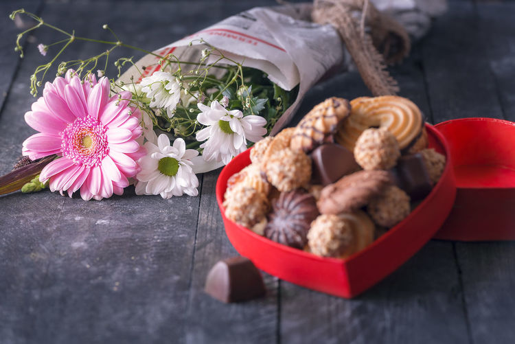 Close-up of cookies and bouquet on table