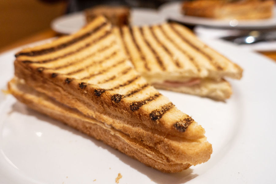 Close up view of a hamd and cheese toasted sandwich. Comfort Food Ham Lunch Meal Toast Cheese Close-up Focus On Foreground Food Food And Drink Freshness Grilled mealtime No People Plate Plates Ready-to-eat Selective Focus Still Life Taste Tasty Toasted Sandwich