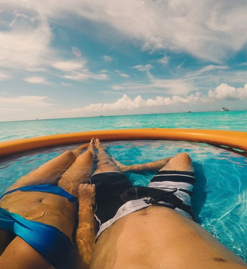 Lounging in the Caribbean! Low Section Sea Horizon Over Water Water Relaxation Sky Person Beach Tranquil Scene Personal Perspective Tranquility Vacations Person Travel Scenics Resting Cloud - Sky Tourism Young Adult Lying Down