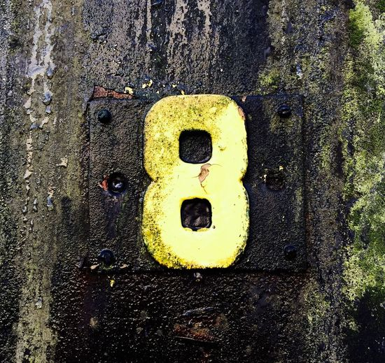 Meine Glückszahl 8️⃣🎉✨ Yellow Close-up No People Black Color Number Communication My Best Photo Outdoors Textured  Backgrounds Symbol Wall - Building Feature Anthropomorphic Smiley Face Road Architecture Day Metal Full Frame Sign Pattern Text