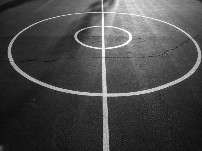The Center of the Basketball Court Blackandwhite Photography EyeEm Selects EyeEm Sports Basketball - Sport Court Competitive Sport Sport Team Sport Leisure Games Backgrounds Full Frame Playing Field Soccer Field Basketball Semi-circle Round Marking Geometric Shape Basketball Hoop LINE Circular