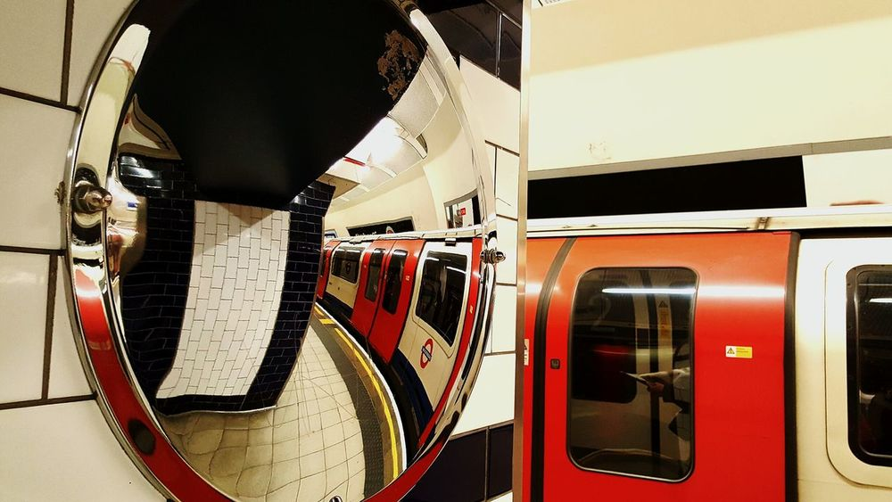 Transportation Red Indoors  No People Close-up Transport Public Transport Platform Station Platform Train Tube Station  Tube Mirror Convex Mirror