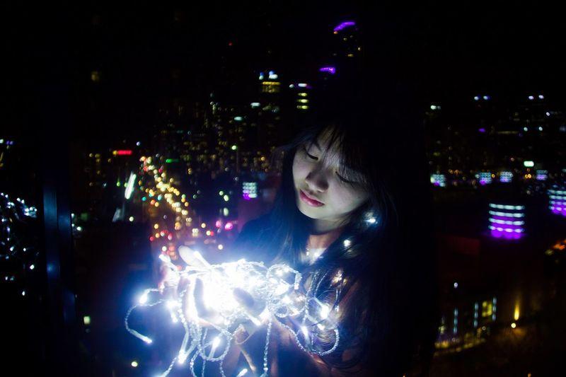 City lights. Night Illuminated Beautiful Woman Young Adult City Christmas Lights Headshot Happiness Outdoors Holding Smiling Window Lifestyles