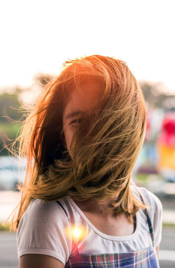 Rear view of woman in hair against sky