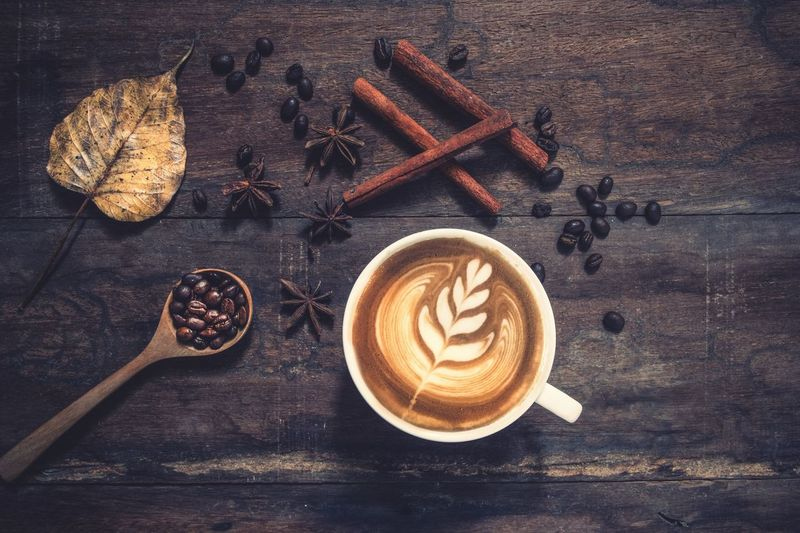 Latte art coffee on wood Vintage Latte Art Food And Drink Coffee - Drink Still Life Drink Coffee Cup Refreshment Hot Drink Cappuccino Coffee Cup Food Frothy Drink Kitchen Utensil Directly Above Spoon Table Mug Freshness Eating Utensil The Foodie - 2019 EyeEm Awards