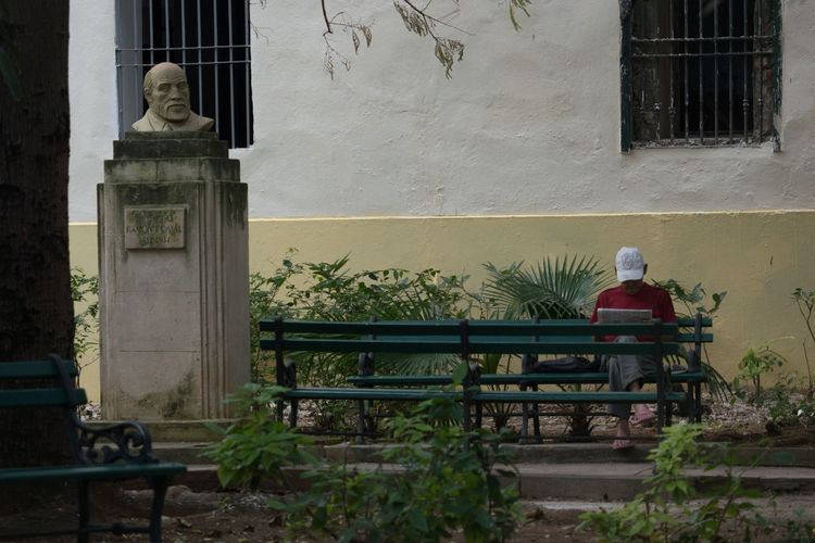 Reading Man Architecture Bench Benches Built Structure Cap Cuba Cuba Collection Day Grids No People Outdoors Reading Man Statue Travel Photography Unrecognizable Person Windows