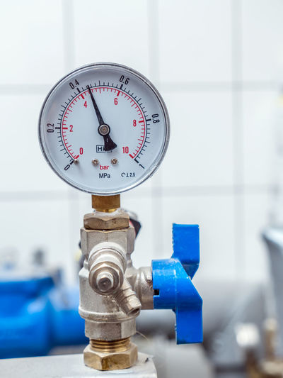 Water valve with pressure gauge mounted in boiler room Boiler Room Close-up Focus On Foreground Gauge Hydraulic Indoors  Industry Installation Instrument Of Measurement Manometer No People Pipes Plumbing Pressure Pressure Gauge Pressure Gauges Supply Technology Water Valve