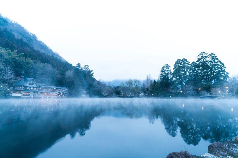 大分県 湯布院 金鱗湖 Reflection Water Beauty In Nature Nature Waterfront Tranquil Scene Lake Scenics Mountain Tranquility Outdoors No People Clear Sky Tree Winter Day Snow Sky Cold Temperature Building Exterior Japan Japan Photography