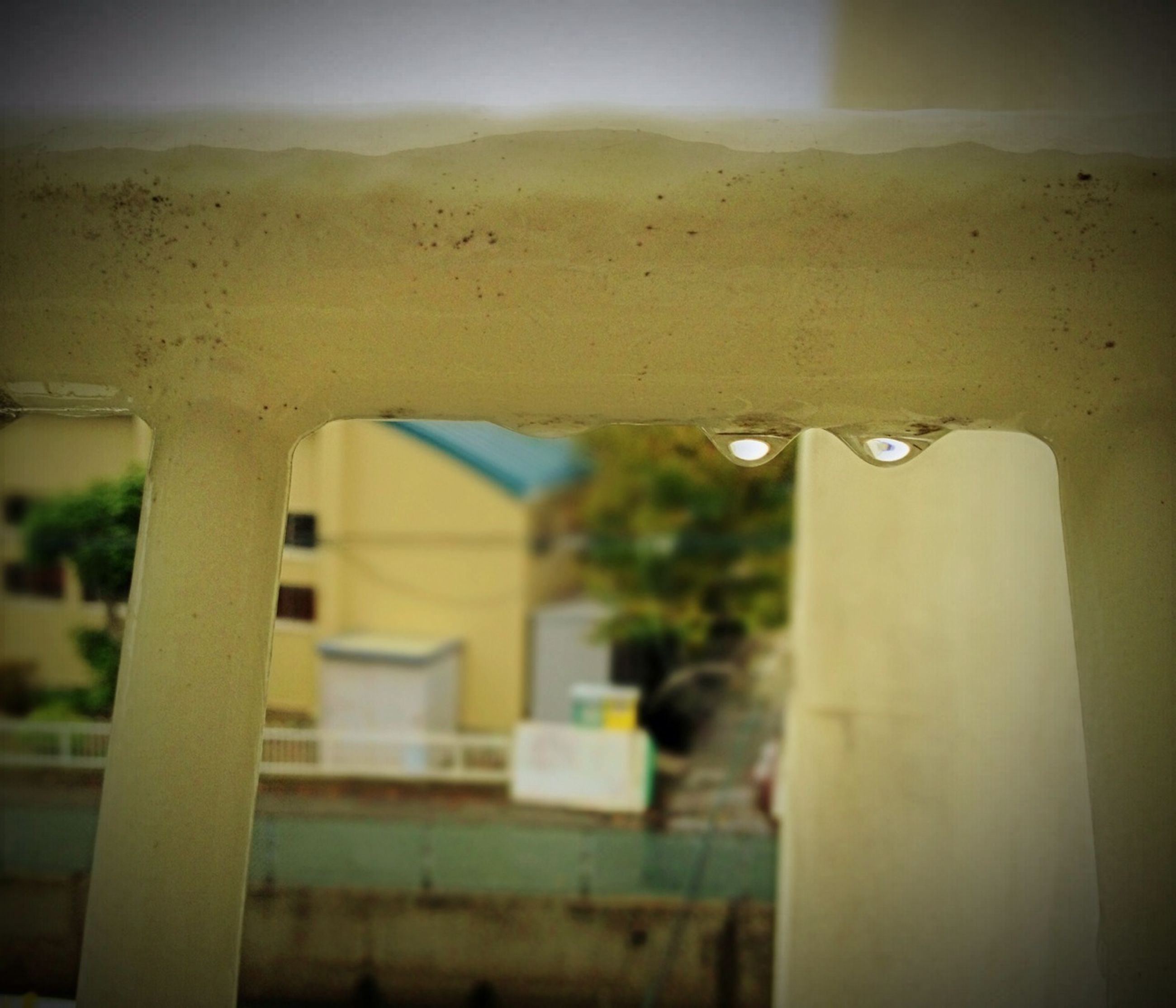 architecture, built structure, building exterior, focus on foreground, drop, close-up, water, sky, wet, window, no people, indoors, selective focus, illuminated, building, day, transparent, sunlight, low angle view
