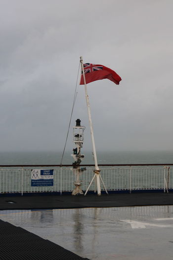 Ferry Built Structure Day Flag Horizon Over Water Nature Nautical Vessel No People Outdoors Patriotism Red Ensign Sea Sky Water