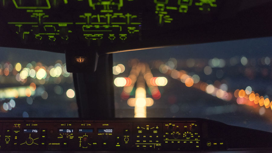 Cockpit Of Commercial Airplane At Night