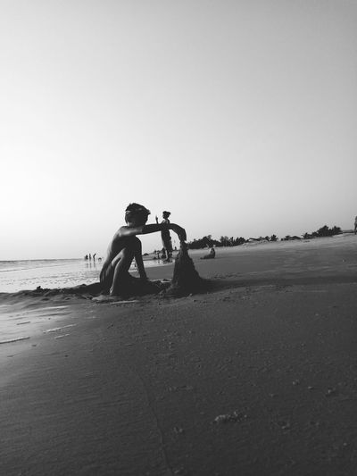 Beach Sand Sea Only Men Adult People Adults Only Childhoodunplugged Childish One Person Sky Nature Water Outdoors Day Looking Photographing TCPM Break The Mold Childhood Memories Innovation Children Playing Children At Play Children Of The World Childhooddays