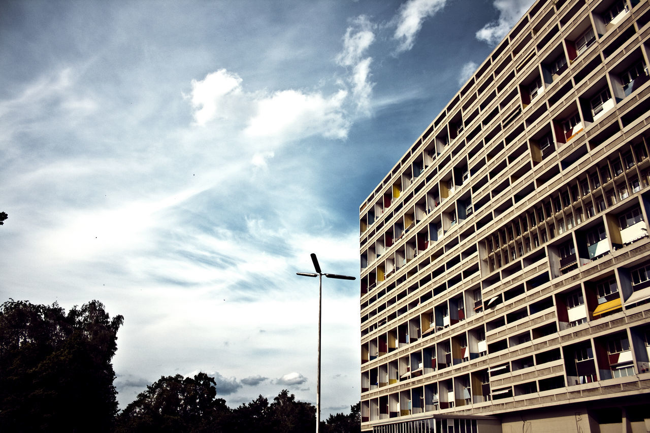 sky, architecture, cloud - sky, building exterior, low angle view, outdoors, no people, built structure, city, day, nature, tree