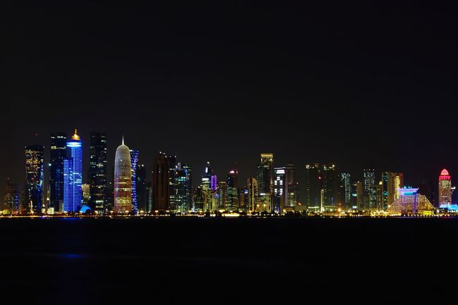 Doha Skyline corniche City Architecture Skyscraper Night Illuminated Building Exterior Urban Skyline Cityscape Built Structure Tower Travel Destinations No People Outdoors Modern Sky Water Downtown District night photography The Architect - 2017 EyeEm Awards