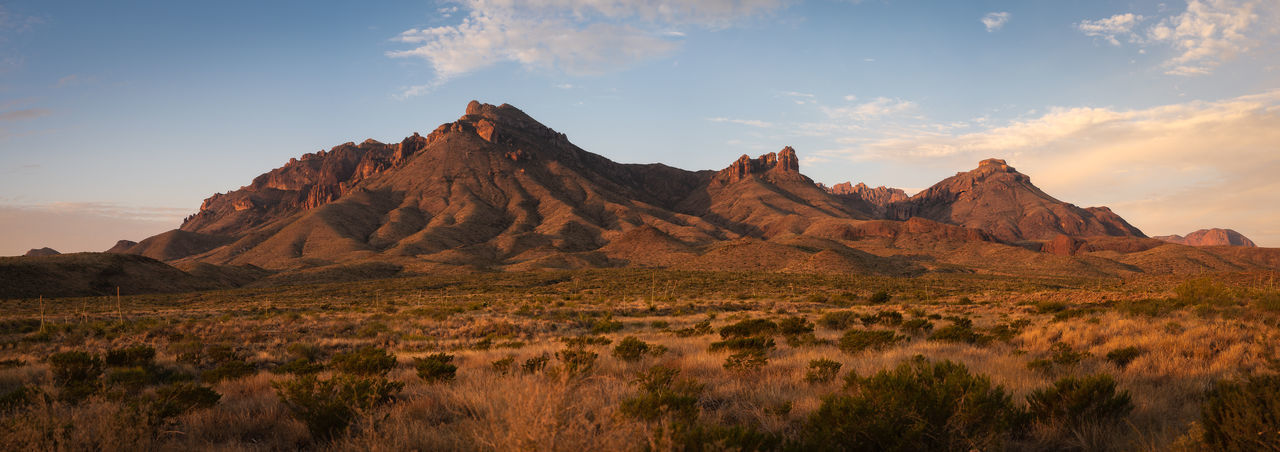 Panoramic view of rock formations on field against sky in big bend national park - texas