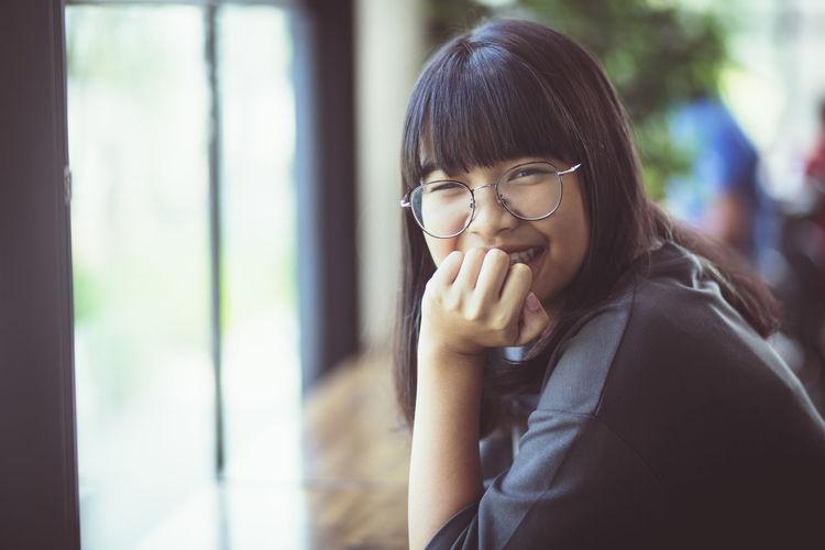Portrait of girl at cafe