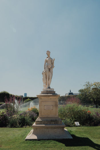 Statue in park against clear sky