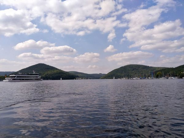 Ship Shipping  Tourism Lake Lake View Water Sea Beach Tree Mountain Swimming Sand Sky Landscape Cloud - Sky Coastline Calm Dramatic Sky Seascape Atmospheric Mood