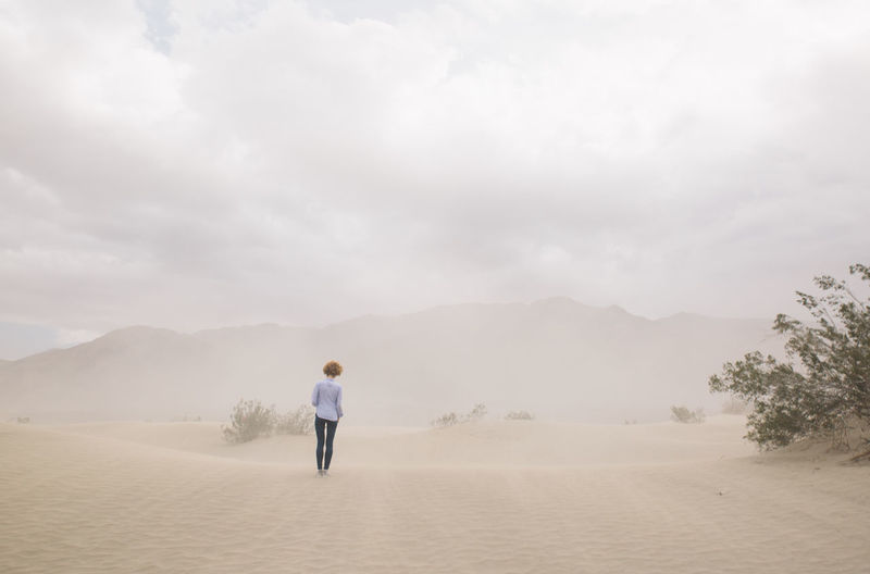 Rear View Of Woman Standing In Desert