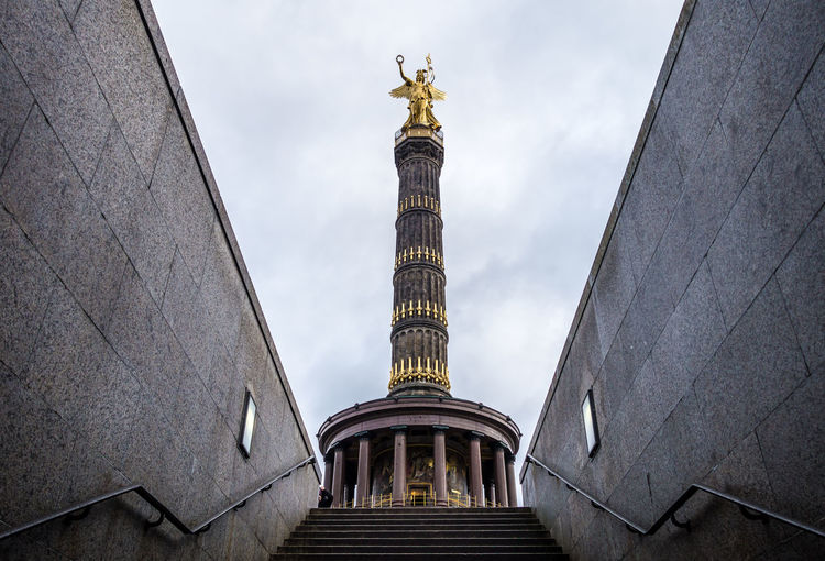 Famous Place Tower Siegessäule  Goldelse Angel Architectural Column Architecture Building Exterior Built Structure City Cloud - Sky Gold Colored History Human Representation Low Angle View Memorial Monument No People Outdoors Representation Sculpture Sky Statue The Past Tourism Travel Travel Destinations Memorial Statue City