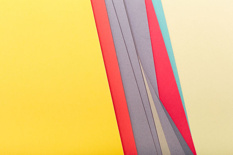 Low angle view of multi colored pencils against clear sky