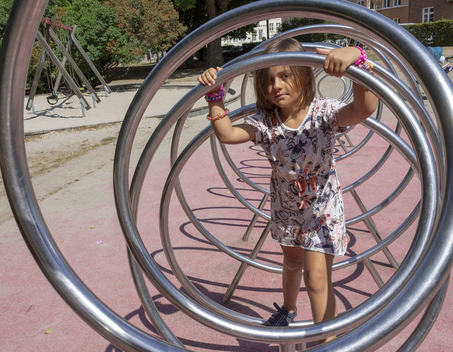 Girl in a playground Child Childhood Girl Leisure Activity One Person Park Playground Standing