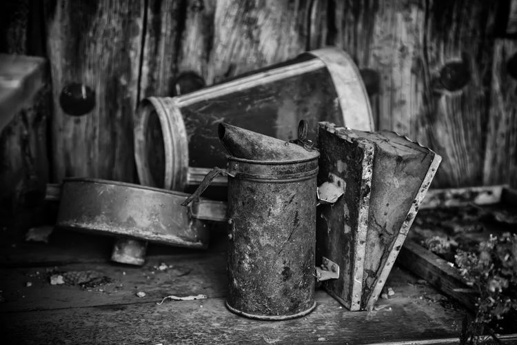 Close-up of old rusty metal containers