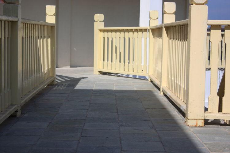 Empty pathway along railings