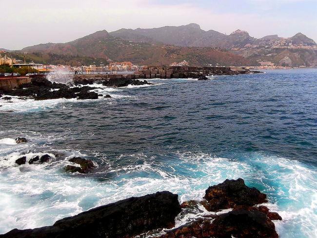 Beauty In Nature Colline Edifici Giardininaxos Mare Massi Mountain Nature No People Outdoors Pietra Lavica Schiuma Marina Sea Sicilia Sky Travel Destinations Water