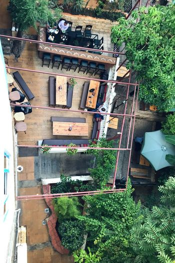 High angle view of building and trees in yard