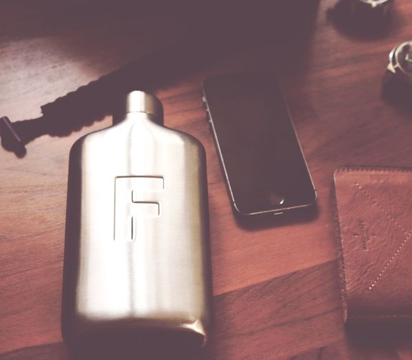 Counter the heat waves by drinking water from a cool flask Fred Water Flask Hard Graft EDC IPhone 5S