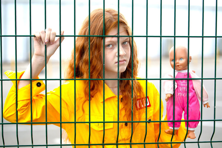 redhead Girl Young Doll Red Redhead Redhair Yellow Clothes Multi Colored Portrait Happiness Prison Looking At Camera Yellow Young Women Smiling Metal Grate Cage Prison Bars Prisoner Hostage Justice - Concept Criminal Pretty The Portraitist - 2019 EyeEm Awards My Best Photo