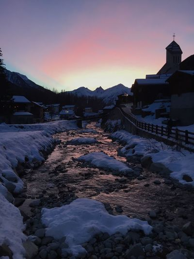 Lötschental Water River Winter Cold Temperature Built Structure Snow Architecture Winter Sunset Sky Mountain Beauty In Nature Environment
