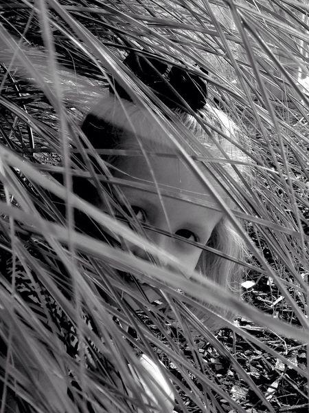 The Portraitist - 2016 EyeEm Awards Black And White Portrait Eyemcaptured Grass Field Portrait Kidsphotography Hide And Seek Moment