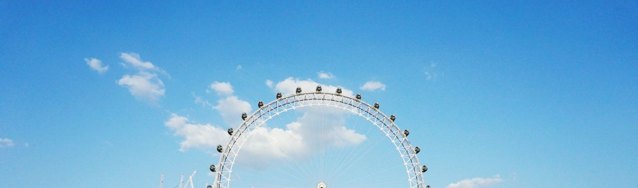 The London Eye Blue Sky White Clouds Blue Sky And Clouds Blue Clouds Divider Banner Half Circle London Eye London Sky Low Angle View Motion Blue Nature Cloud - Sky Day Architecture No People Outdoors Built Structure Copy Space Travel Travel Destinations The Traveler - 2018 EyeEm Awards A New Perspective On Life
