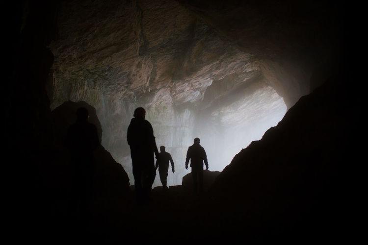 Silhouette Men In Cave