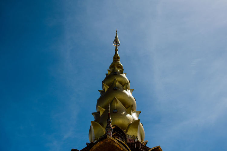 Belief Religion Spirituality Sky Place Of Worship Built Structure Building Low Angle View Architecture Gold Colored No People Building Exterior Nature Sculpture Statue Day Blue Art And Craft Outdoors Spire