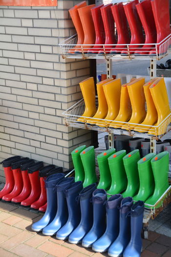 Multi Colored Rubber Boots Arranged In Rack