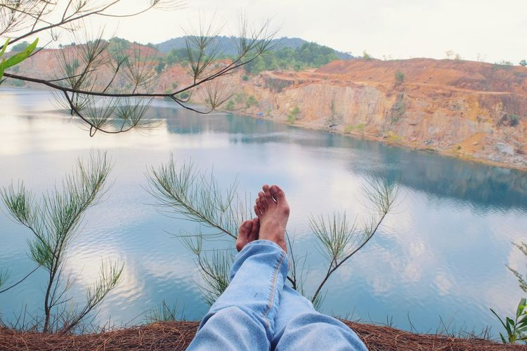 Enjoying Life Enjoy Enjoying The View Fresh Daylight Freshness Cliff Cliffside Water One Person Low Section Limb Human Leg Personal Perspective Nature Human Body Part Leisure Activity Adults Only Lake Adult Reflection Real People Lifestyles Human Foot Day Beauty In Nature Outdoors Scenics