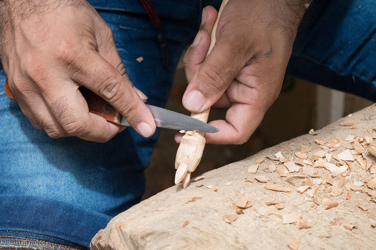 Cropped Hands Of Carpenter Working In Carpentry Workshop