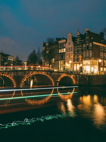 Amsterdam Architecture Night Illuminated Building Exterior Built Structure Water River Bridge - Man Made Structure Waterfront Travel Destinations City Long Exposure Cityscape Sky No People